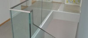 Frameless glass balustrade added to corbellian stairs