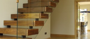 Equilibrium open stairs with walnut steps