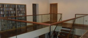 Stairwell guard railing with clear toughened glass