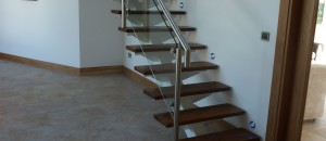Glider modern stairs with stainless steel and glass infill balustrade