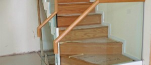 Inca closed rise stairs finished with 15 mm toughened glass
